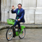 Arnold Schwarzenegger arrives by electric bicycle to the city hall of Paris